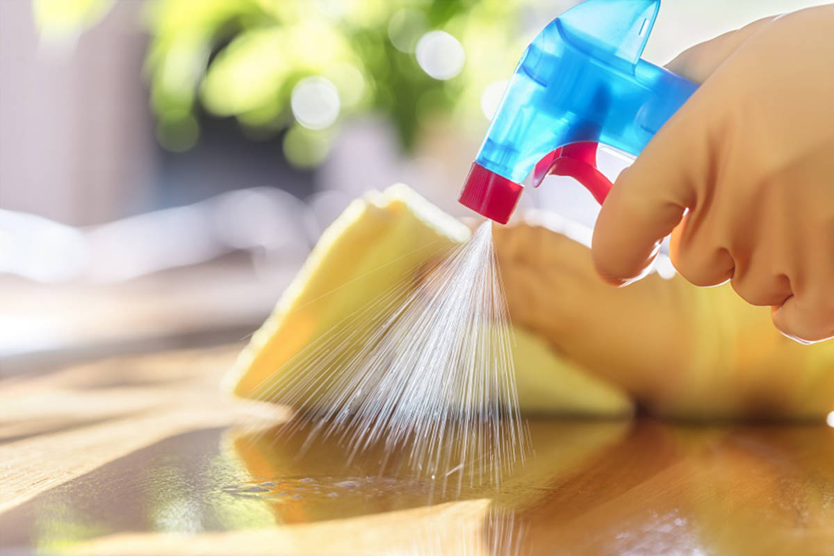 Cleaning with spray detergent, rubber gloves and dish cloth is the safest way to clean a surface. (BCCDC photo)