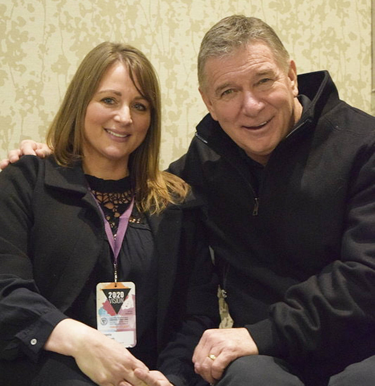 Angela Evennett takes a moment to pause for a photo with the Man in Motion, Rick Hansen. Angela is a big supporter of the Rick Hansen Foundation.