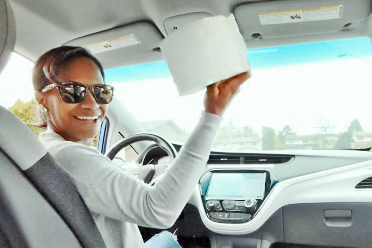 Betty Gilbert special education assistant Cherise Ostafew throws toilet paper to another teacher in the video – via social distance – from her car. (Special to the Aldergrove Star)