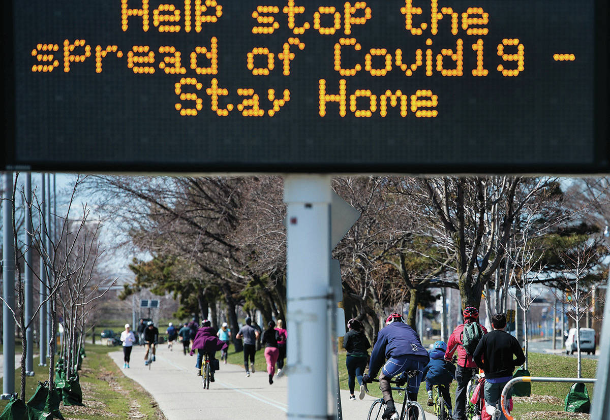 People get exercise outside on the lake shore path along Lake Ontario in Toronto on Thursday, April 2, 2020. Health officials and the government has asks that people stay inside to help curb the spread of the coronavirus also known as COVID-19. THE CANADIAN PRESS/Nathan Denette