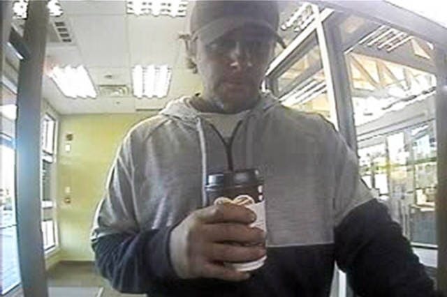 Nanaimo RCMP hope the public can help identify a man they allege used a found bank card left in an ATM machine and used it to pull $1,000 out of the victim's bank account. (Photo submitted)