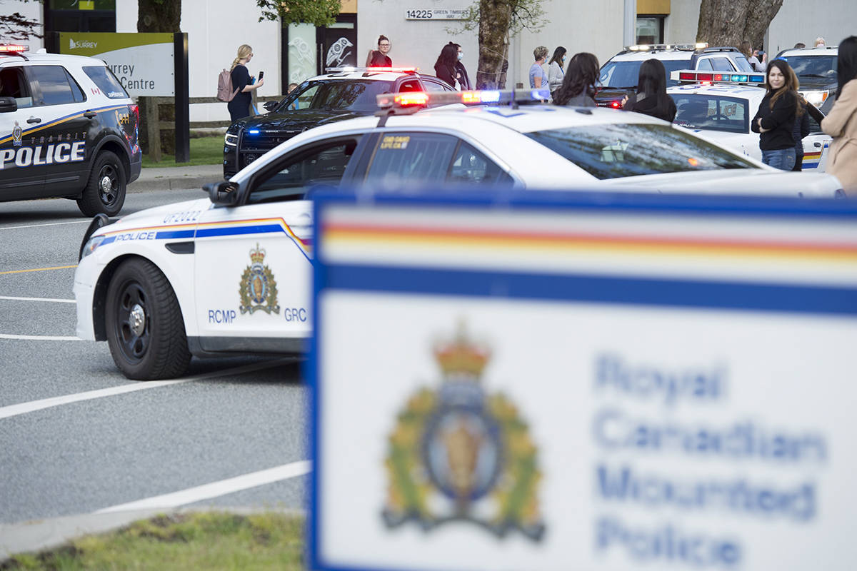 Members of B.C. law enforcement take part in a motorcade to honour fallen RCMP Const. Heidi Stevenson at the RCMP headquarters in Surrey, B.C. Thursday, April 30, 2020. Const. Stevenson was shot and killed in Nova Scotia on April 19th. THE CANADIAN PRESS/Jonathan Hayward
