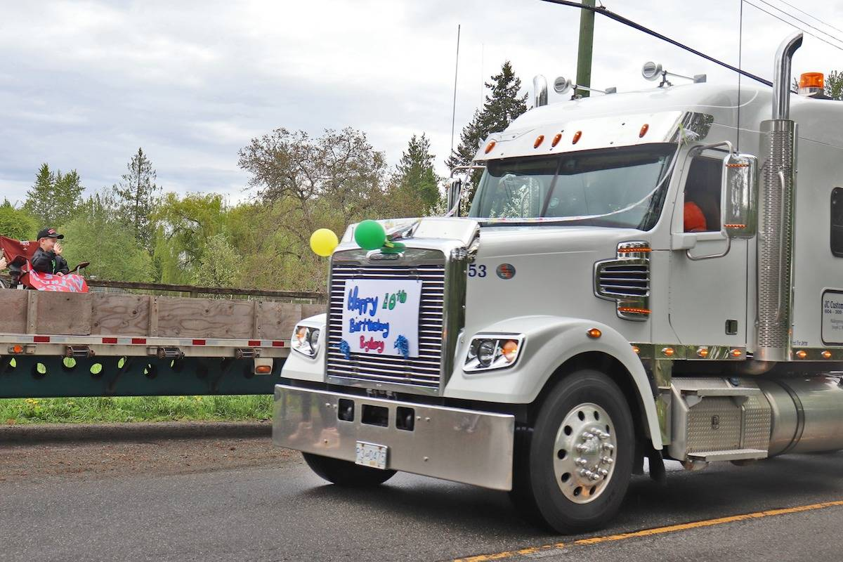 """The last semi in the Ryley Grin's big rig birthday parade on Saturday was Ryley's """"dad,"""" or grandfather, who surprised him with a dirtbike. (Sarah Grochowski photo)"""