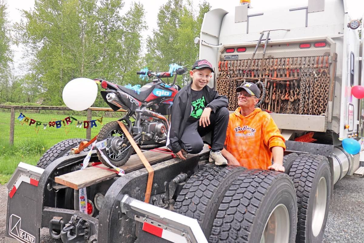 "The last semi in the Ryley Grin's big rig birthday parade on Saturday was Ryley's ""dad,"" or grandfather, who surprised him with a dirtbike. (Sarah Grochowski photo)"