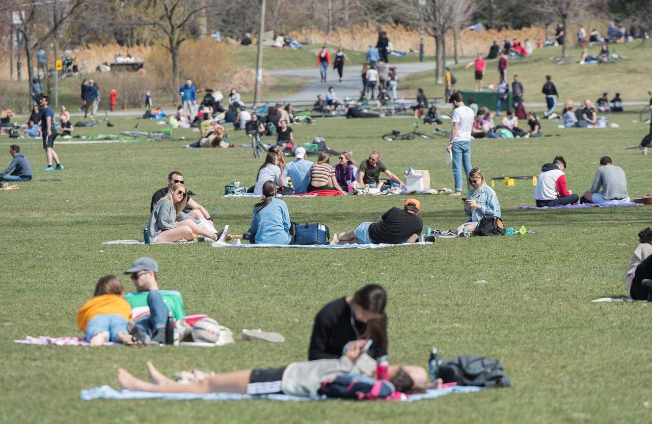 People enjoy a warm day in a park in Montreal, Saturday, May 2, 2020, as the COVID-19 pandemic continues in Canada and around the world. THE CANADIAN PRESS/Graham Hughes