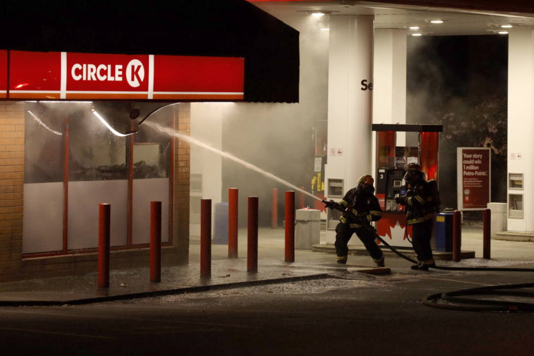 Nanaimo Fire Rescue firefighters put out a fire inside the Circle K convenience store on Departure Bay Road on Saturday night. (Dylan Phillips photo)