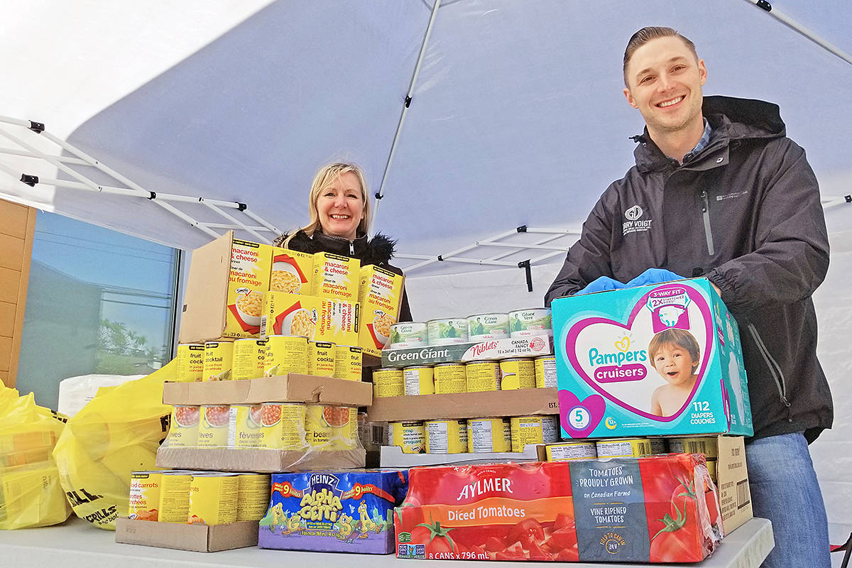 Donations were piling up Sunday (May 3rd) at a drive-in donation event for the Langley Food Bank held at 197th Street and 64th Avenue. Donna Dalkie and Garry Voigt of Royal LePage Wolstencroft Realty announced a new goal after an initial target of $2,000 worth of contributions was quickly surpassed. (Dan Ferguson/Langley Advance Times)