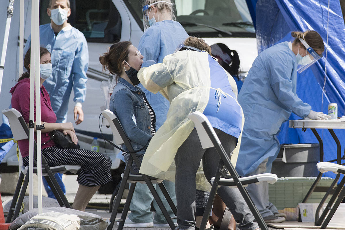 A woman is tested for COVID-19 at a mobile clinic in the Montreal neighbourhood of Saint-Michel, Sunday, May 3, 2020, as the COVID-19 pandemic continues in Canada and around the world. THE CANADIAN PRESS/Graham Hughes