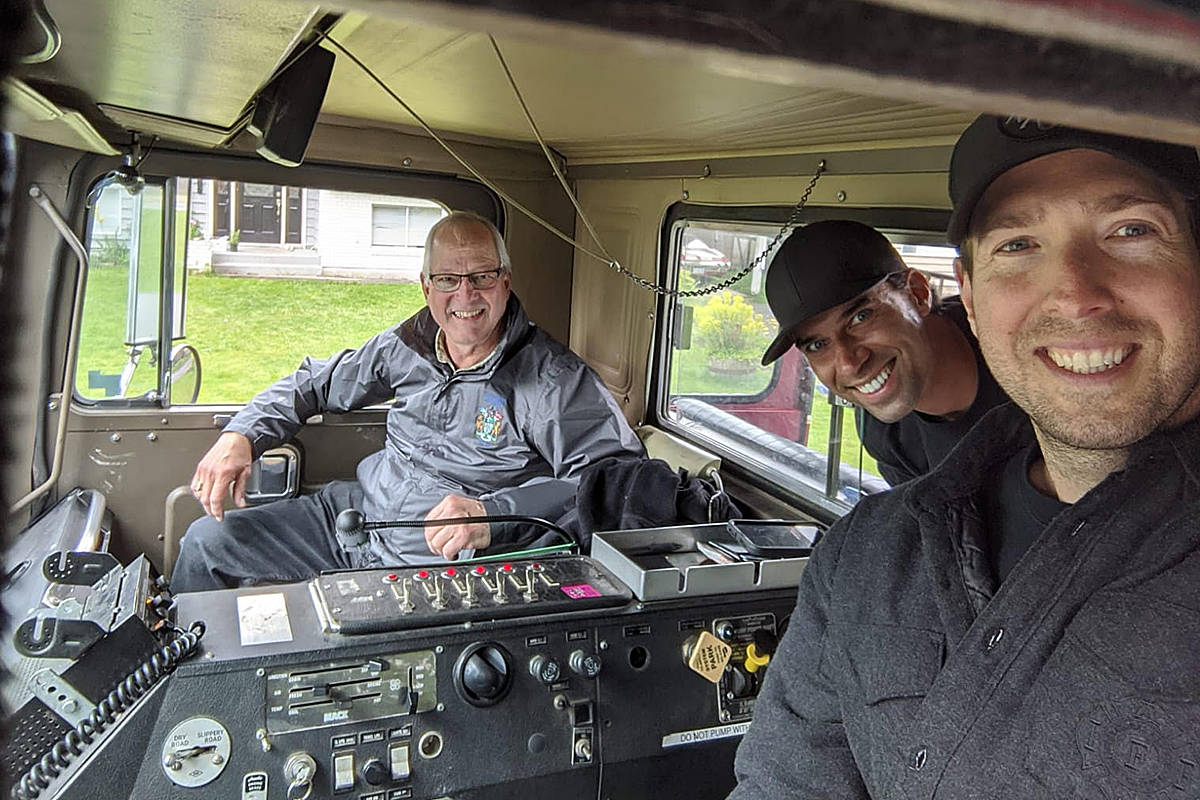 Langley Township Mayor Jack Froese (left) with firefighters Gareth Lockhart (driving) and Matthew Szydlowski delivered wishes for happy birthdays around the community on Sunday. (Langley Township Firefighters Charitable Society)