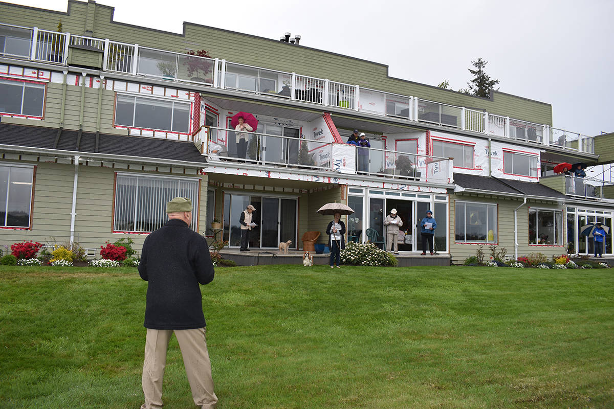 Every Monday at 5 p.m., residents at Windsong, a Courtenay strata complex, converge on their respective balconies to sing a song, in appreciation of the work being done by all frontline workers during the COVID-19 crisis. Photo by Terry Farrell