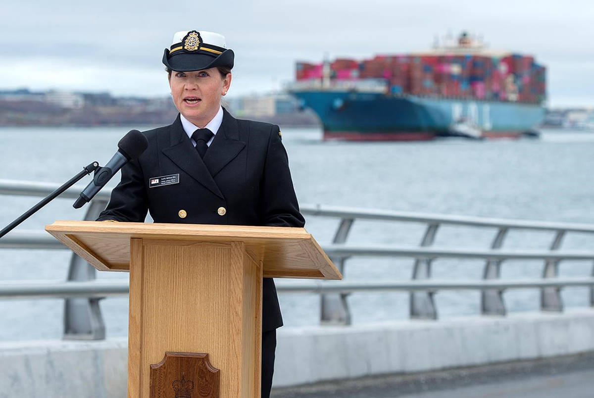 Lt. Melissa Kia, speaking on the behalf of the next of kin of Sub-Lt. Matthew Pyke, reads a statement at the navy dockyard in Halifax on Tuesday, May 5, 2020. Pyke perished in the crash of a CH-148 Cyclone helicopter. The helicopter was flying a mission from the Halifax-class frigate HMCS Fredericton and crashed off the coast of Greece while taking part in an exercise as part of a NATO operation in the Mediterranean. THE CANADIAN PRESS/Andrew Vaughan