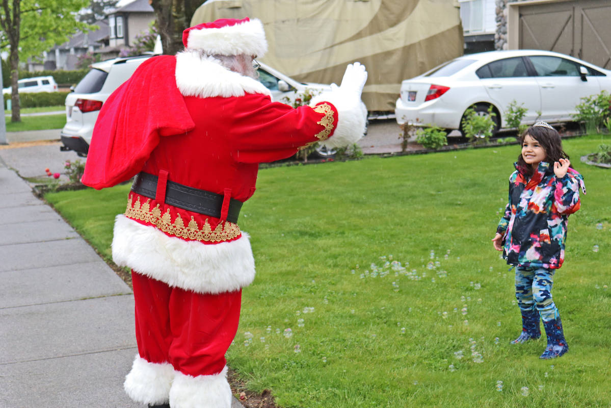 Aldergrove's Ariel Seydel, who is battling brain cancer, greeted Santa Claus at a safe distance on Saturday, May 2, as people from the community drove by for a surprise birthday parade. (Sarah Grochowski photo)