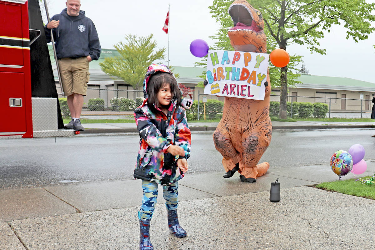 Aldergrove resident Ariel Seydel, who is battling brain cancer, danced to Baby Shark on her sixth birthday, Saturday, during a surprise visit from an anonymous dancing dinosaur. (Sarah Grochowski photo)