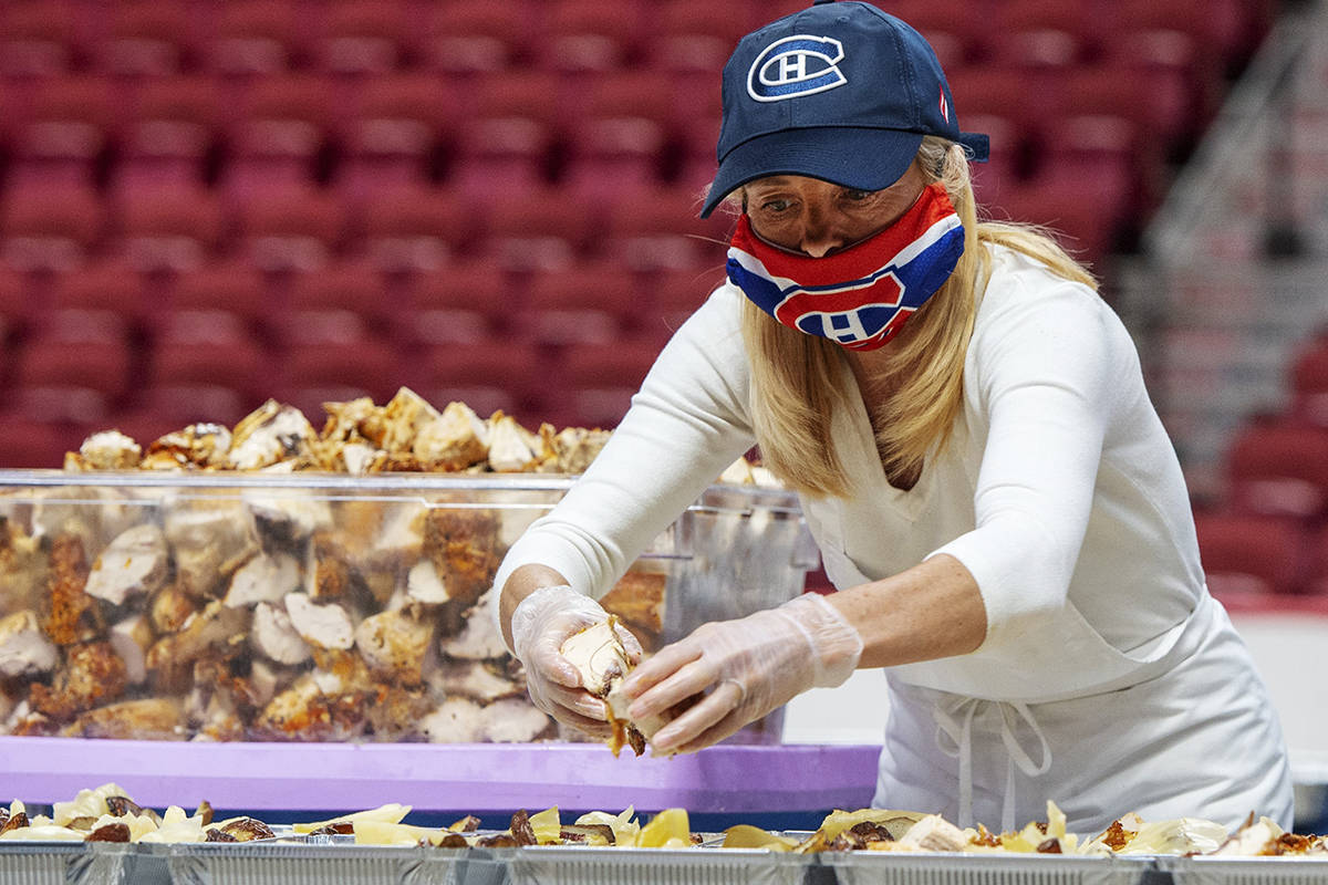 A volunteer prepares a meal for food banks on the floor of the Bell Centre, Tuesday May 5, 2020 in MontrealTHE CANADIAN PRESS/Ryan Remiorz