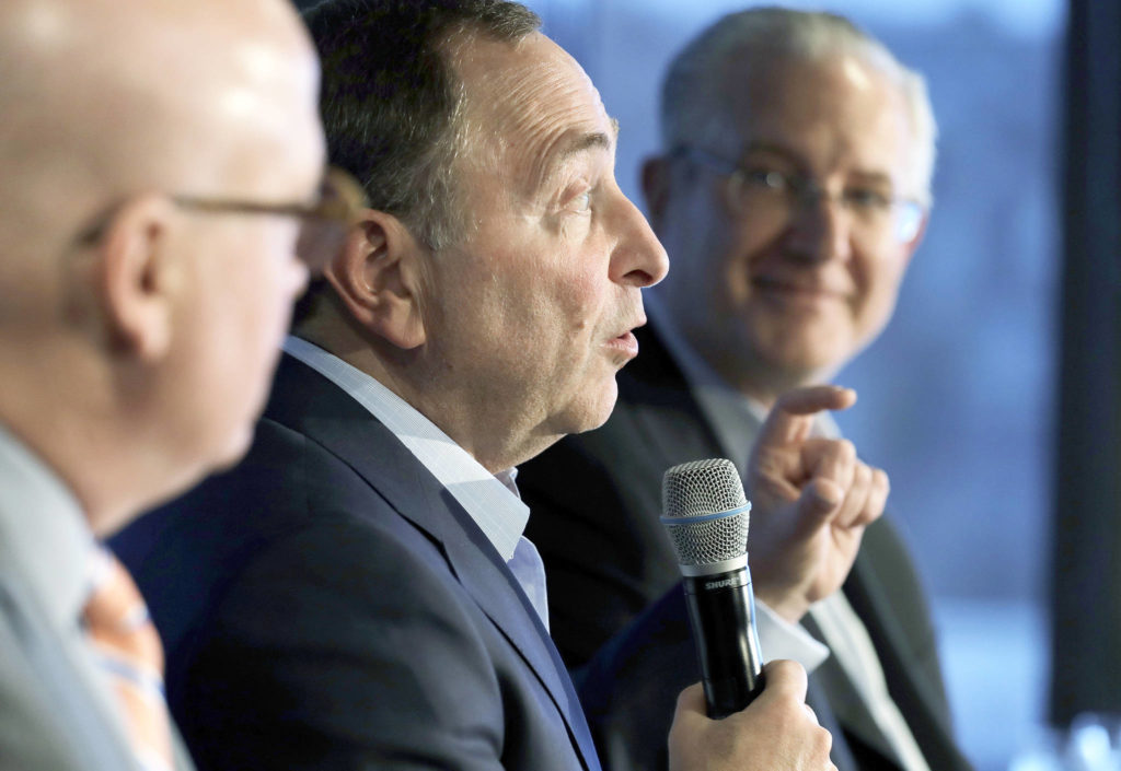 The Associated Press NHL Commissioner Gary Bettman, center, joins Deputy Commissioner Bill Daly, left, and Tod Leiweke, right, president and CEO of the Seattle Hockey Partners group, during a news conference in Seattle.