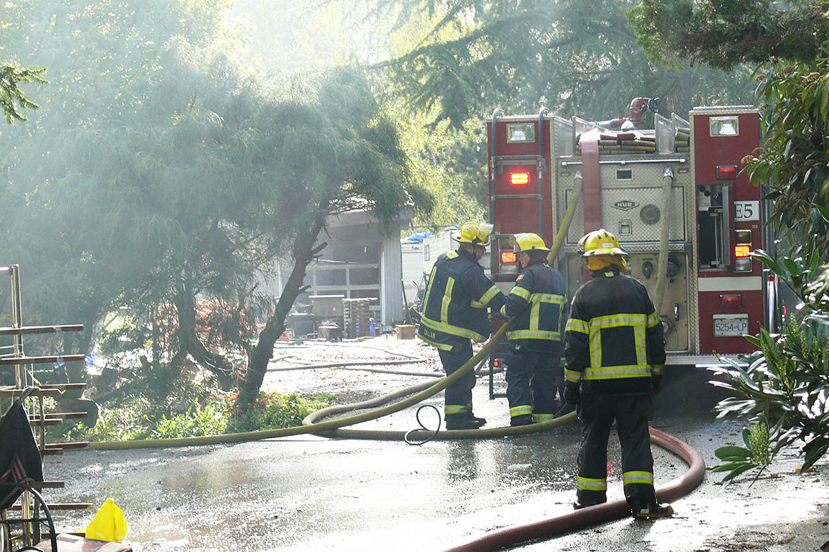 The cost of dozens of Langley Township firefighters putting out a blaze at an empty home will be charged back to the owner. (Dan Ferguson/Langley Advance Times)