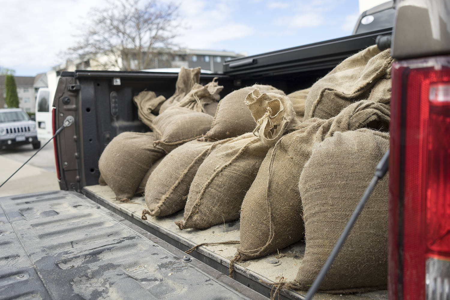 Sandbags in the back of a truck as Pacific Court residents combat early morning flooding on May 7, 2020. (Michael Rodriguez - Kelowna Capital News)