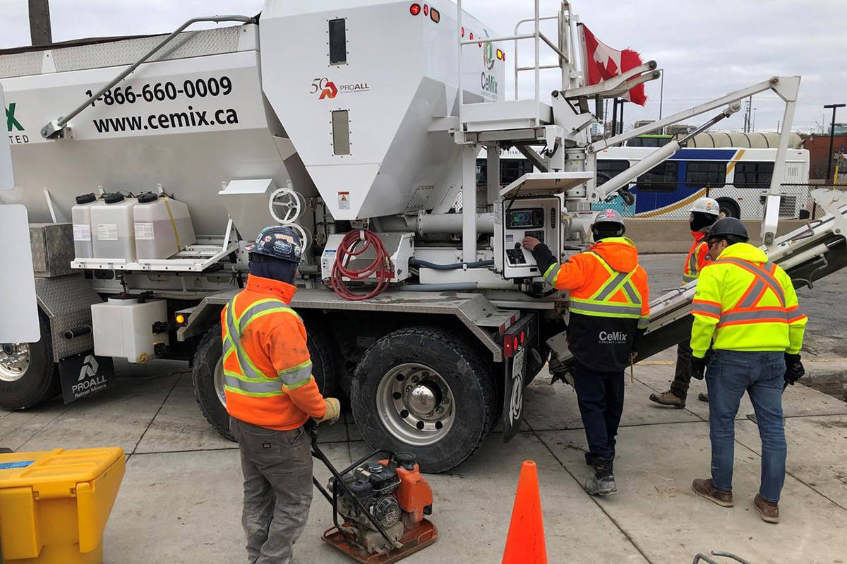 Workers get set to pour cement from a truck at the GO train station in Oakville, Ont., Tuesday, Jan.28, 2020. Statistics Canada is set today to report how many workers lost their jobs in April or had their hours slashed as a result of the COVID-19 pandemic.THE CANADIAN PRESS/Richard Buchan
