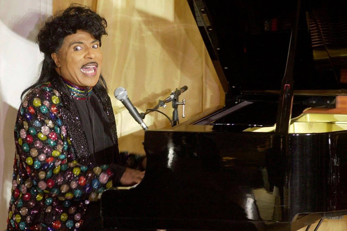 "FILE - In this July 22, 2001 file photo, Little Richard performs at the 93rd birthday and 88th year in show business gala celebration for Milton Berle, in Beverly Hills, Calif. Little Richard, the self-proclaimed ""architect of rock 'n' roll"" whose piercing wail, pounding piano and towering pompadour irrevocably altered popular music while introducing black R&B to white America, has died Saturday, May 9, 2020. (AP Photo/John Hayes, File)"