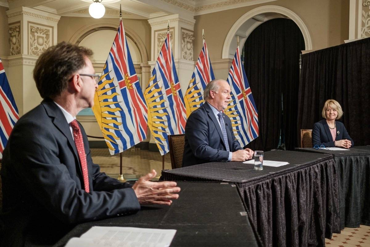 B.C Health Minister Adrian Dix, Premier John Horgan and provincial health officer Dr. Bonnie Henry present their plan to gradually reopen services and businesses in the COVID-19 pandemic, B.C. legislature, May 6, 2020. (B.C. government)