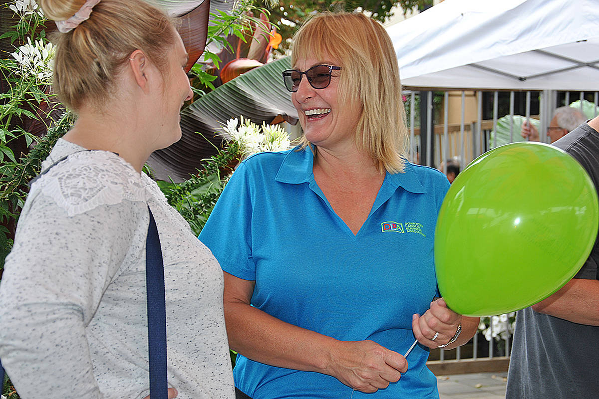 Teri James, executive director of the Downtown Langley Business Association (right) during the 2019 Arts Alive Festival that drew a record crowd. She announced Monday, May 11 that the 2020 event will not be happening due to COVID. (Langley Advance Times files)