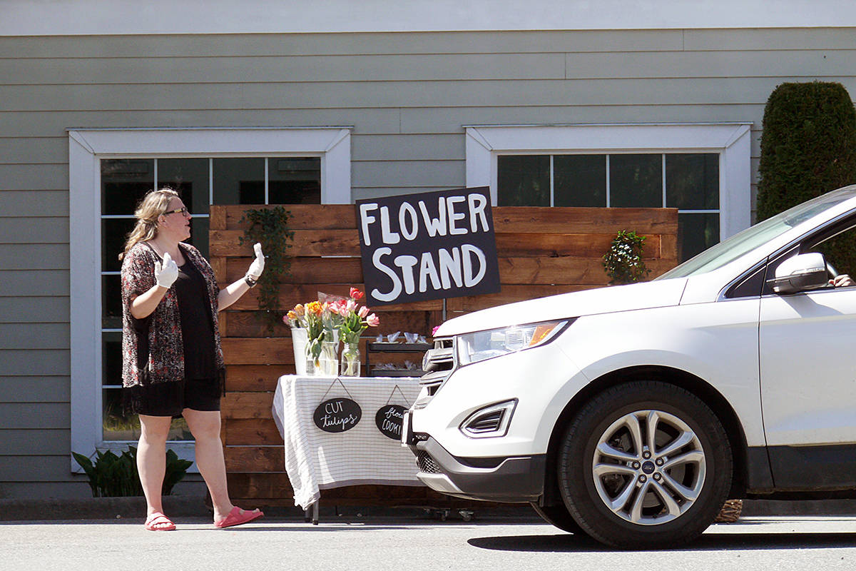 Dee-Ana Goodman, children's pastor at the Living Waters church in Fort Langley, guided a visiting vehicle to a stop Sunday, May 10th, during a drive-through Mother's Day celebration at the Glover Road place of worship. (Dan Ferguson/Langley Advance Times)