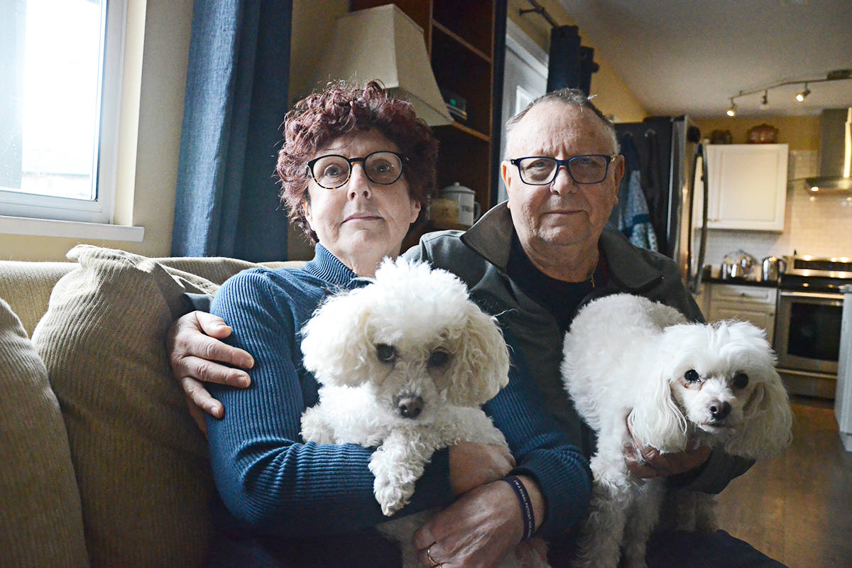 Shelagh Brennan and her husband, Bryan Frazer, with their dogs Maggie and Perla. Her kidney transplant is among 30,000 non-urgent procedures placed on hold in B.C. because of the COVID-19 outbreak. (Langley Advance Times files)