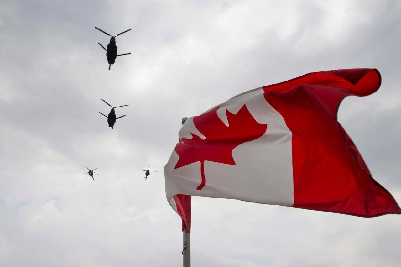 Canadian Forces CH-47 Chinook helicopters participate in a flyover of Parliament Hill in Ottawa on Friday, May 9, 2014. The Canadian Armed Forces is postponing the deployment of a warship and surveillance aircraft to help enforce United Nations' sanctions against North Korea because of the COVID-19 pandemic. THE CANADIAN PRESS/Justin Tang