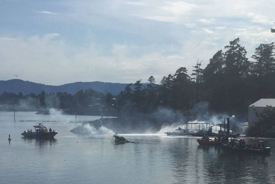 A large plume of smoke was spotted by the North Saanich marina on Sunday afternoon. (Wolf Depner/News Staff)
