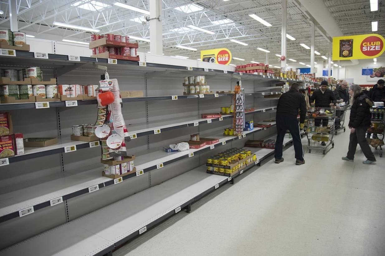 Empty shelves are pictured at a grocery store in North Vancouver, B.C. Monday, March 16, 2020. Statistics Canada says grocery store sales continued to be high in the week ending April 11, up 19 per cent year-over-year, but they were below the spike seen in mid-March when initial COVID-19 emergency measures were announced. THE CANADIAN PRESS/Jonathan Hayward