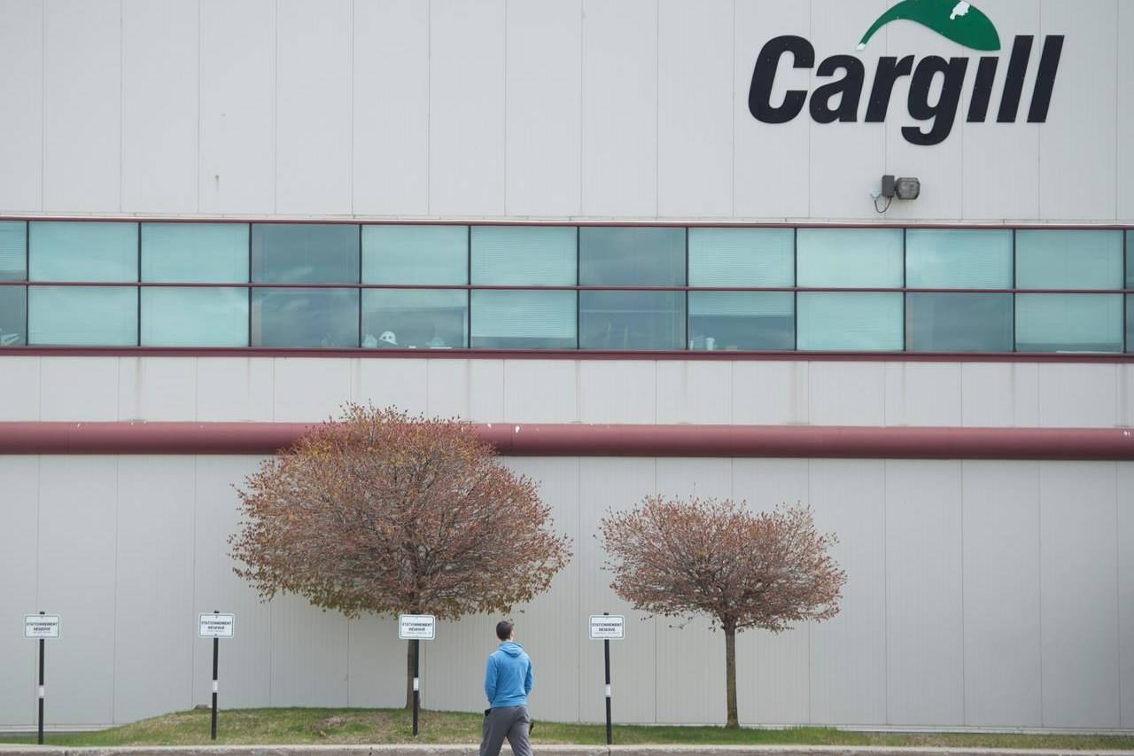 A man walks into a Cargill meat processing factory in Chambly, Que., south of Montreal, Sunday, May 10, 2020. The plant is closing temporarily after at least 64 workers tested positive for COVID-19. Canada's Agriculture Union fears the Canadian Food Inspection Agency will order non-meat inspectors into infected meat plants, under threat of discipline.THE CANADIAN PRESS/Graham Hughes