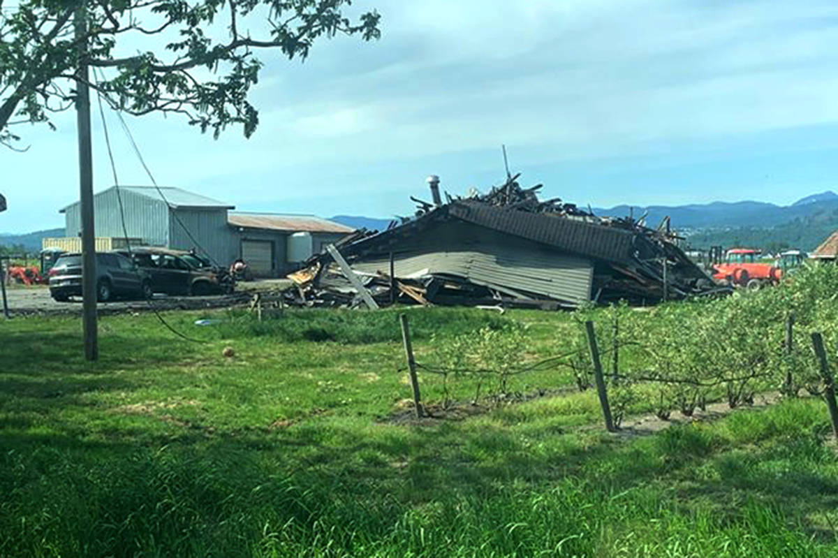 A fire on Hallert Road in Abbotsford on Saturday afternoon destroyed a two-storey home and all the possessions inside, as well as damaging two vehicles. The seven family members who lived there were able to safely escape. (Submitted photo)