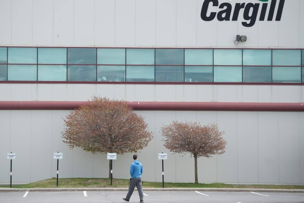 A man walks into a Cargill meat processing factory in Chambly, Que., south of Montreal, Sunday, May 10, 2020. THE CANADIAN PRESS/Graham Hughes