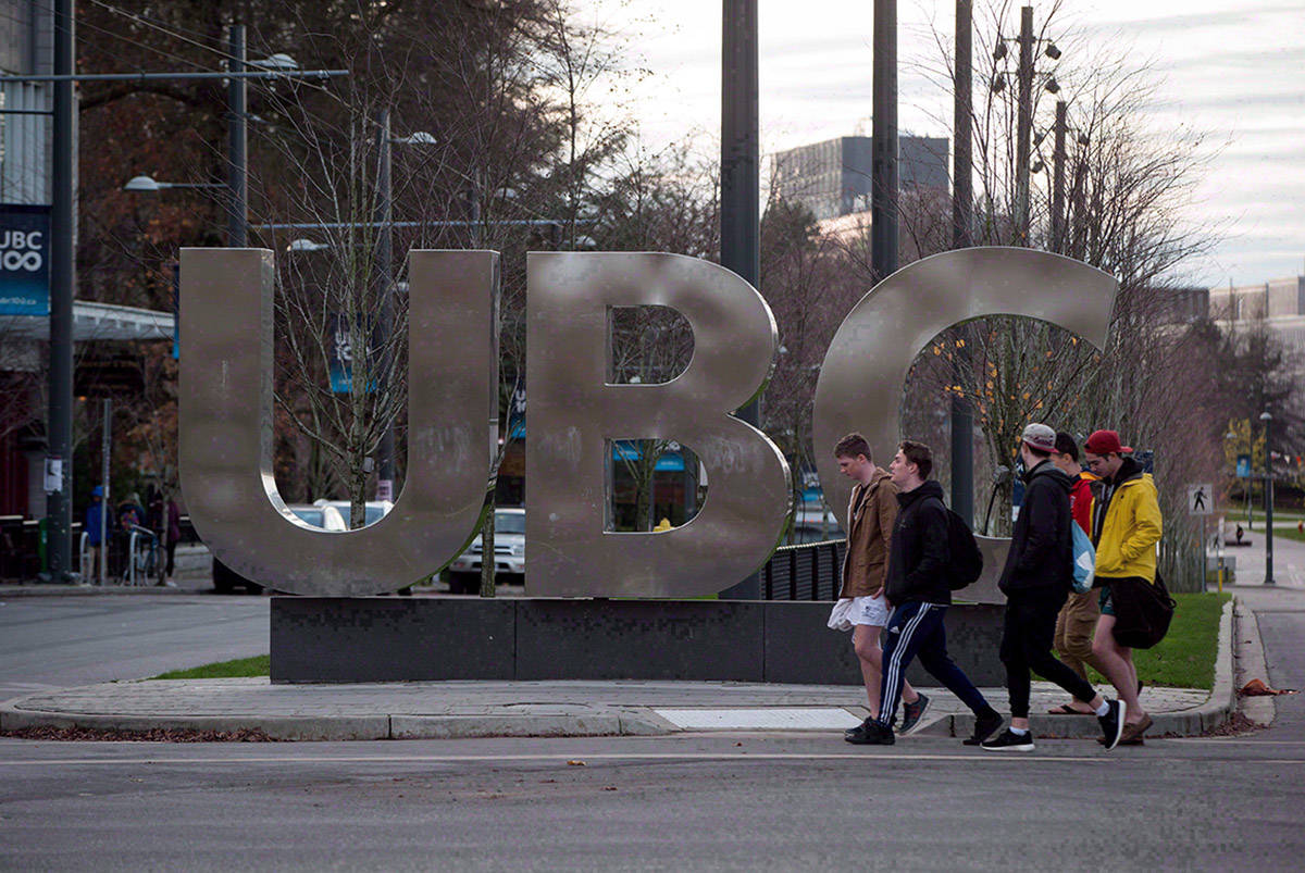 FILE – People walk past large letters spelling out UBC at the University of British Columbia in Vancouver, B.C., on November 22, 2015. THE CANADIAN PRESS/Darryl Dyck