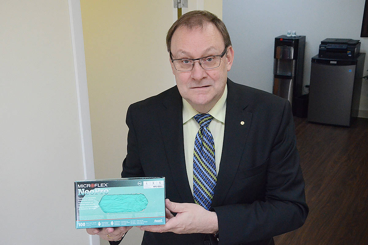Ian Elliott of Arbutus Funeral Services in Langley is worried about running out of basic supplies like protective gloves. Across B.C., funeral homes are having trouble sourcing more PPE. (Matthew Claxton/Langley Advance Times)
