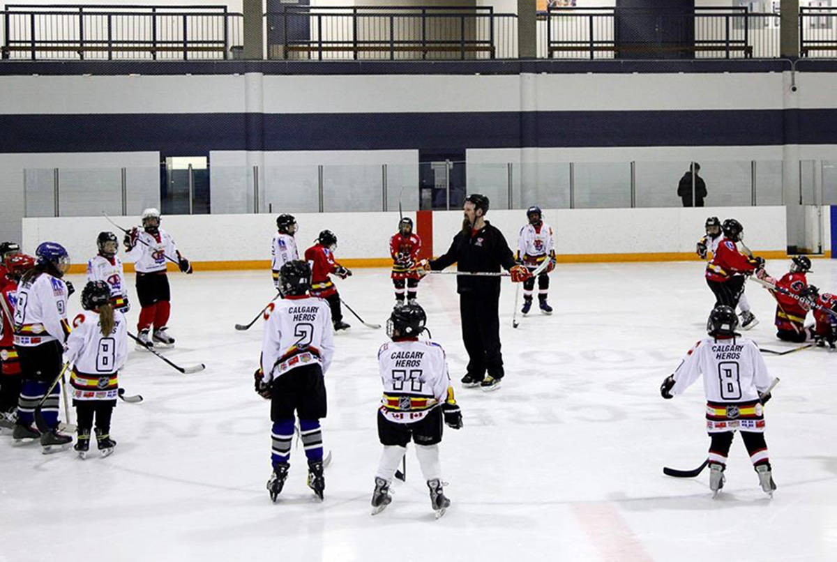 Children take instruction during a practice session in Calgary, Alta., Thursday, Dec. 20, 2012. Minor hockey associations across Canada have had to cut their seasons due to the COVID-19 pandemic, and many of them are trying to determine when they will resume and how to make the game safe for children. THE CANADIAN PRESS/Jeff McIntosh