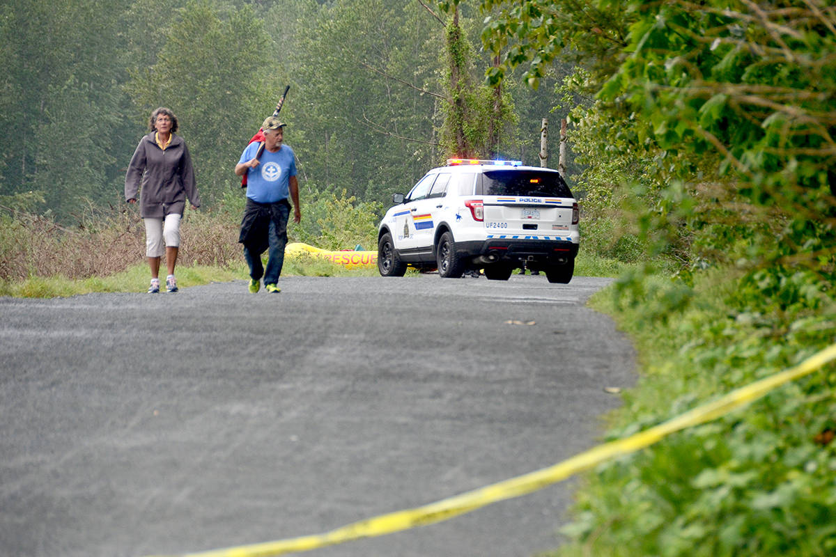 Chilliwack Search and Rescue and Chilliwack RCMP on the Vedder Rotary Trail in the morning on May 12, 2020 after a body of a person that went missing a day prior was recovered in the Vedder River. (Paul Henderson/ The Progress)