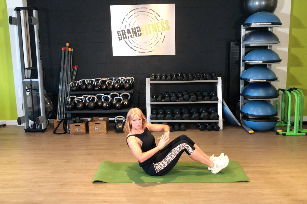 Marion Brand, owner of Brand Fitness in Langley, focuses on working out the core and leads readers in a stretch in this week's edition of Workout Wednesday hosted by Langley Advance Times. (Brand Fitness video screen shot)