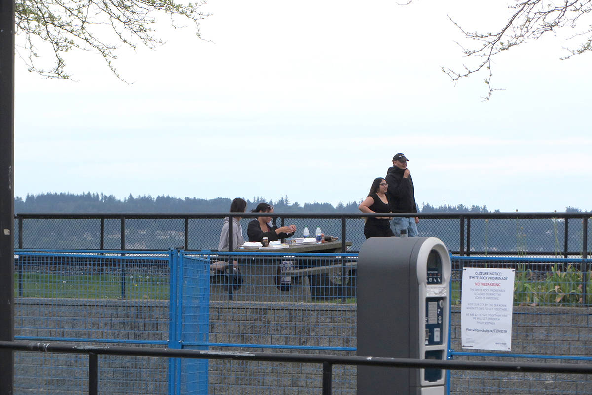 Despite the fact it was closed to the public in early April, people walk and picnic on the White Rock promenade during the May 9-10 weekend. On Monday, council voted to spend up to $10,000 for additional policing along the waterfront during the upcoming Victoria Day long weekend to help enforce social distancing. (Garry Wolgemuth photo)