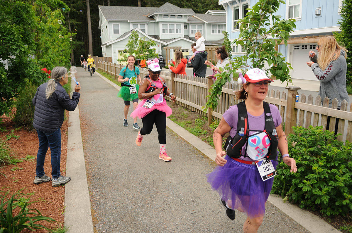 """Runners take part in the """"San Juasn't"""" half marathon on Saturday, May 16, 2020. The event was created by trainer Shelley Hatfield after the San Juan Island Half, which her team trained more than a year for, was cancelled. (Jenna Hauck/ The Progress)"""
