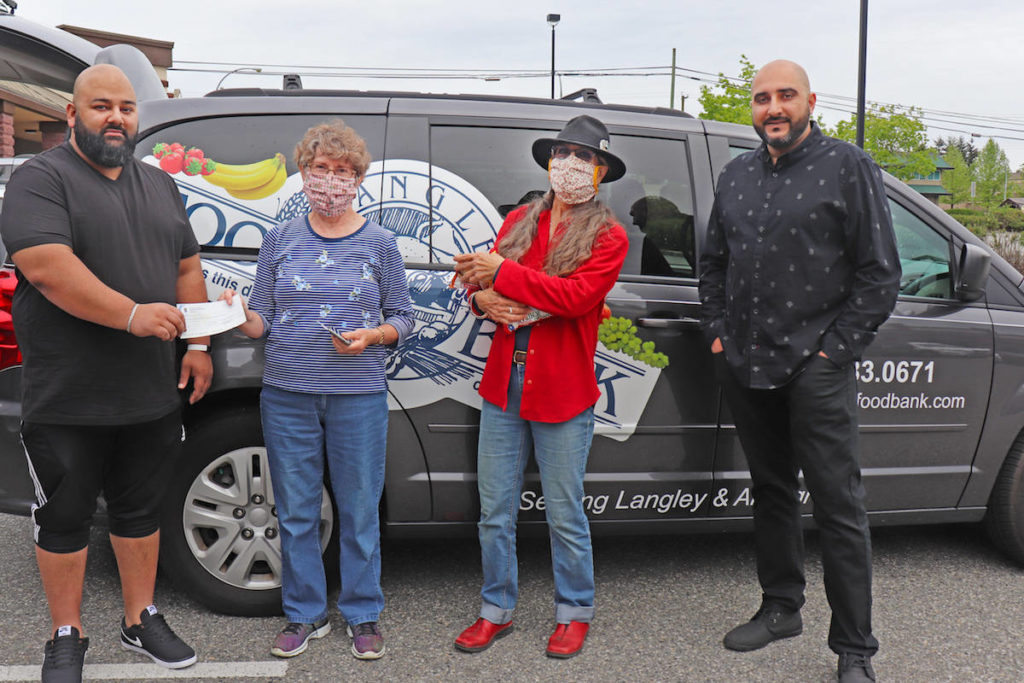 Sunny Sharma and Sukh Mahil presented Aldergrove Food Bank managers Mary van Zuuk and Tannis Percival a cheque for their first two month's rent on Saturday, May 16. (Sarah Grochowski photo)