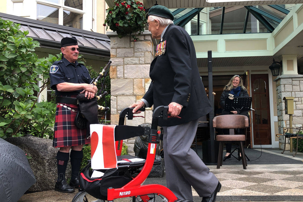 John Hillman completed his 101st lap for charity to the sound of applause and bagpipes outside the Carlton House retirement home. (Devon Bidal/News Staff)