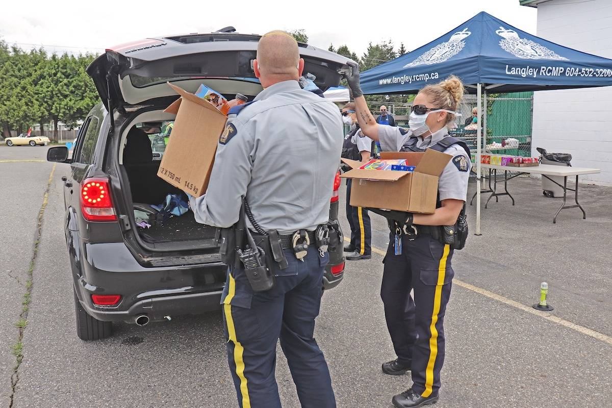 Langley Mounties garner hundreds in food donations, $2,000 from Aldergrove drive-bys