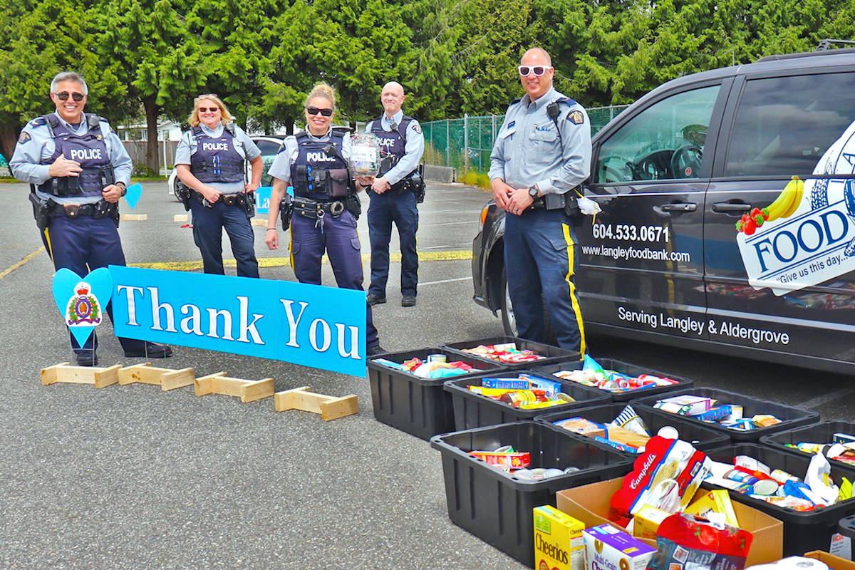 Langley RCMP collected 13 large bins of food donations and more than $2,000 in cash – in the span of three hours on Thursday, May 14. (Sarah Grochowski photo)