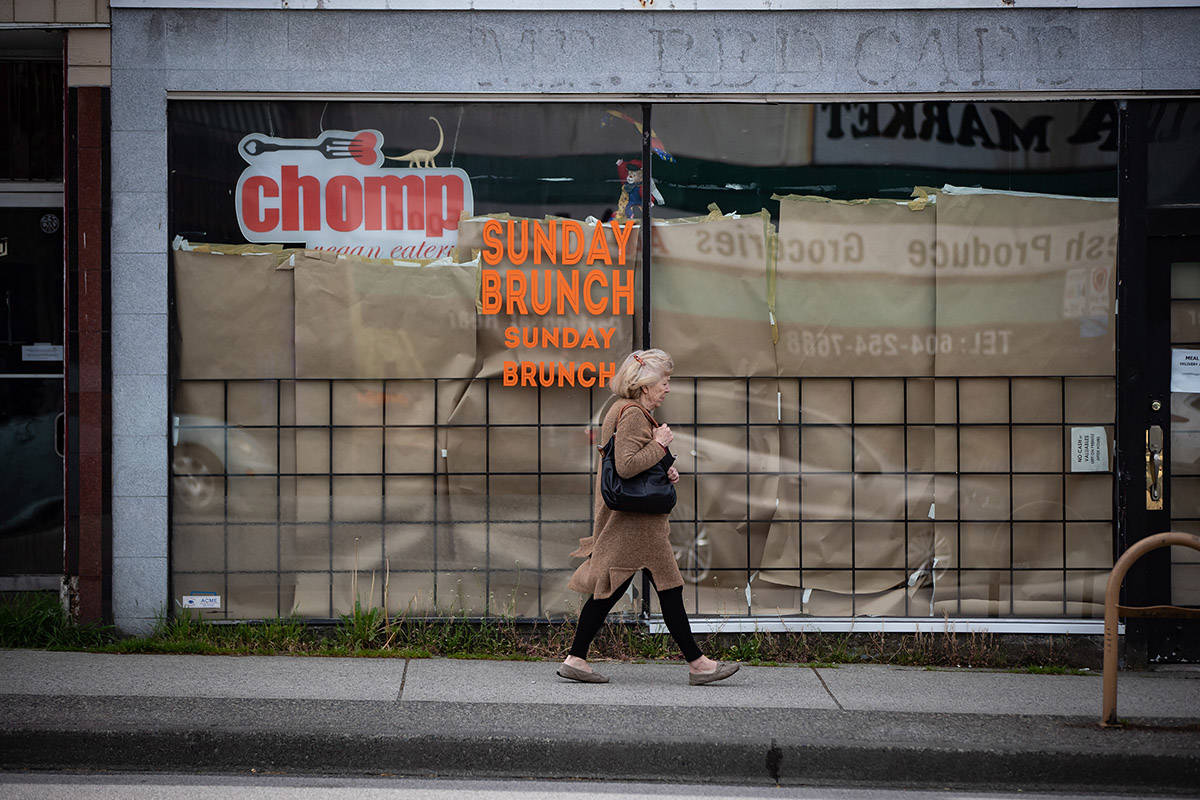 A woman walks past a restaurant closed due to COVID-19, in Vancouver, on May 6, 2020. When the federal government announced a new measure aimed at reducing rent for small businesses by three quarters, it sparked hope of survival among restaurateurs. However, without buy-in from landlords — some of whom have decided to take a wait-and-see approach due to what they say is a lack of clarity — the program will fail to provide relief to those who need it most. The Canada Emergency Commercial Rent Assistance program will allow landlords to apply for government funds to cover half of rent payments for small businesses, up to $50,000 a month, with tenants paying 25 per cent. Landlords would forfeit the remaining 25 per cent. THE CANADIAN PRESS/Darryl Dyck
