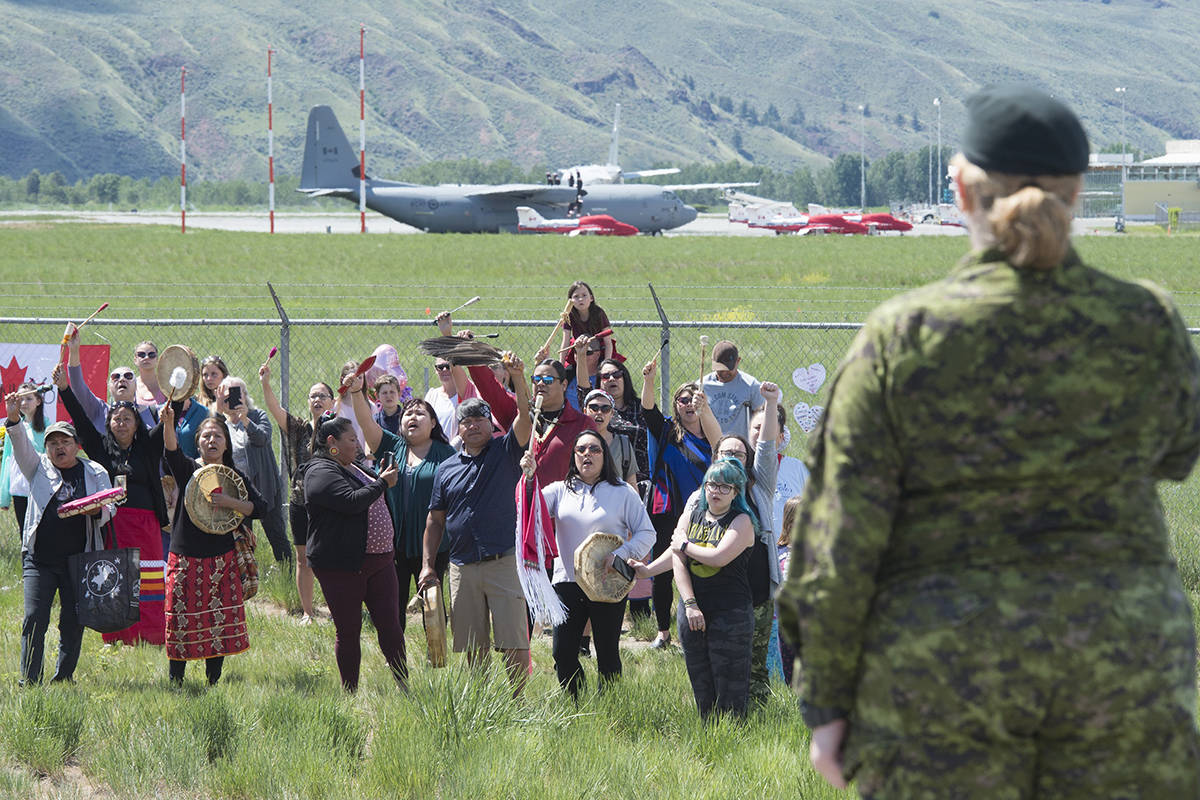 First Nations drummers salute Royal Canadian Air Force Public Affairs Officer Lt. Alexandra Hejduk during a drum ceremony to remember fallen Snowbirds Capt. Jenn Casey in Kamloops, B.C., Monday, May 18, 2020. Capt.Casey died Sunday after the Snowbirds jet she was in crashed shortly after takeoff. The pilot of the aircraft is in hospital with serious injuries. THE CANADIAN PRESS/Jonathan Hayward