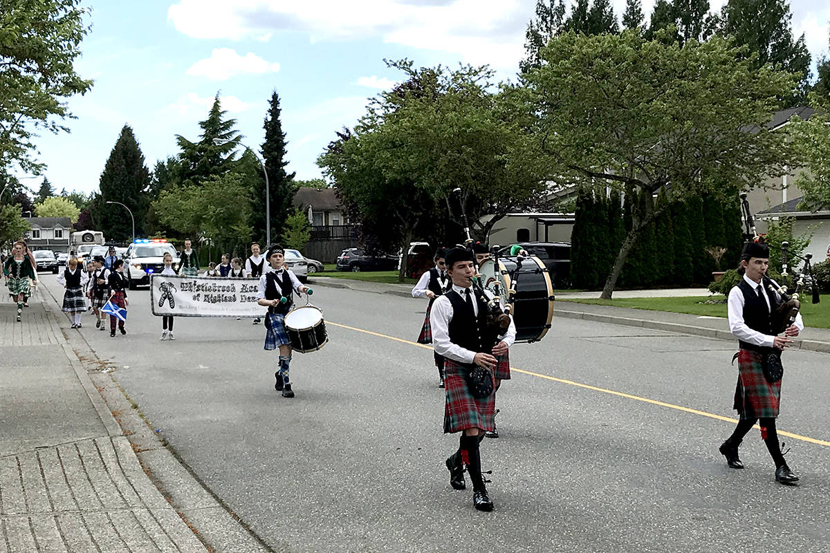 Young Langley Highland dancers and bagpipers perform for seniors