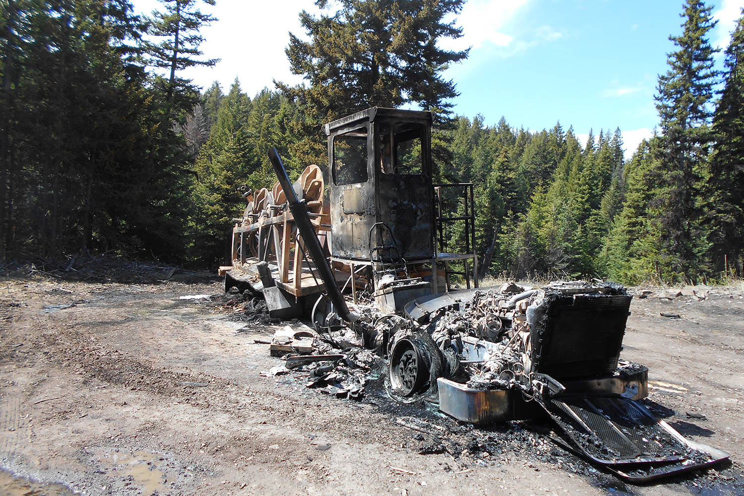 A blue Peterbilt rope truck on a Trans Mountain Expansion Project site near Merritt, B.C. was the target of an act of vandalism and theft one day and the subject of a suspicious blaze another. (Contributed)
