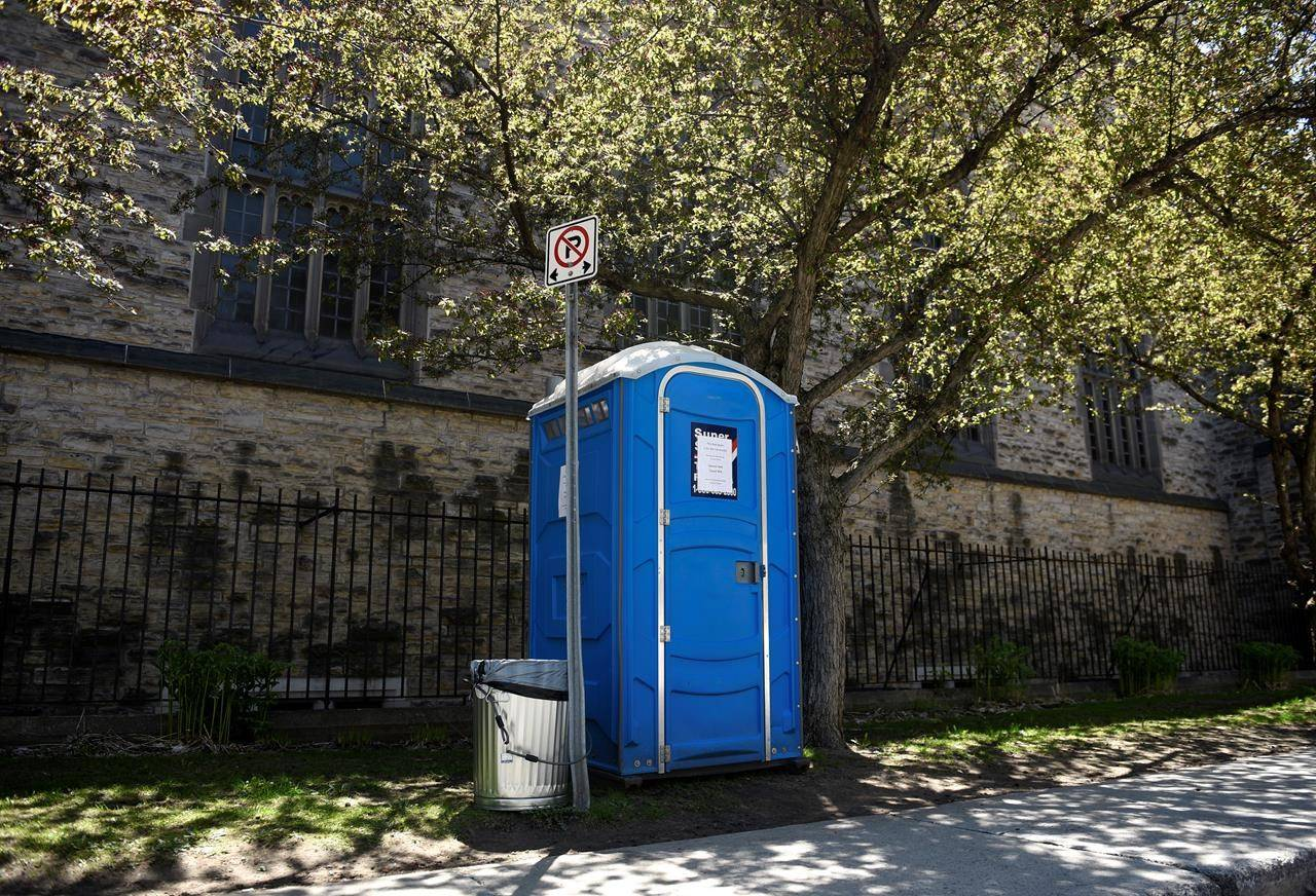 A porta-pottie beside Knox Presbyterian Church in downtown Ottawa, placed to allow people including those who are homeless or precariously housed to access a washroom, is seen on Wednesday, May 20, 2020 during the COVID-19 pandemic. THE CANADIAN PRESS/Justin Tang