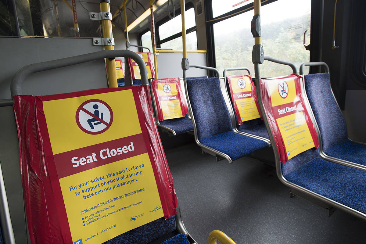 Signs indicating seats which are closed to promote physical distancing during the COVID-19 pandemic are pictured on a public transit bus in North Vancouver, B.C., Tuesday, May 12, 2020. THE CANADIAN PRESS/Jonathan Hayward